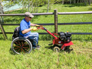 Man-using-wheelchair-using-rotary-hoe