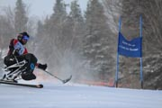 British-Columbia;Canada;adaptive-skiing;alpine-skiing;downhill-racing;male;man;mountain;sit-ski;ski;ski-racing;snow;wheelchair;whistler